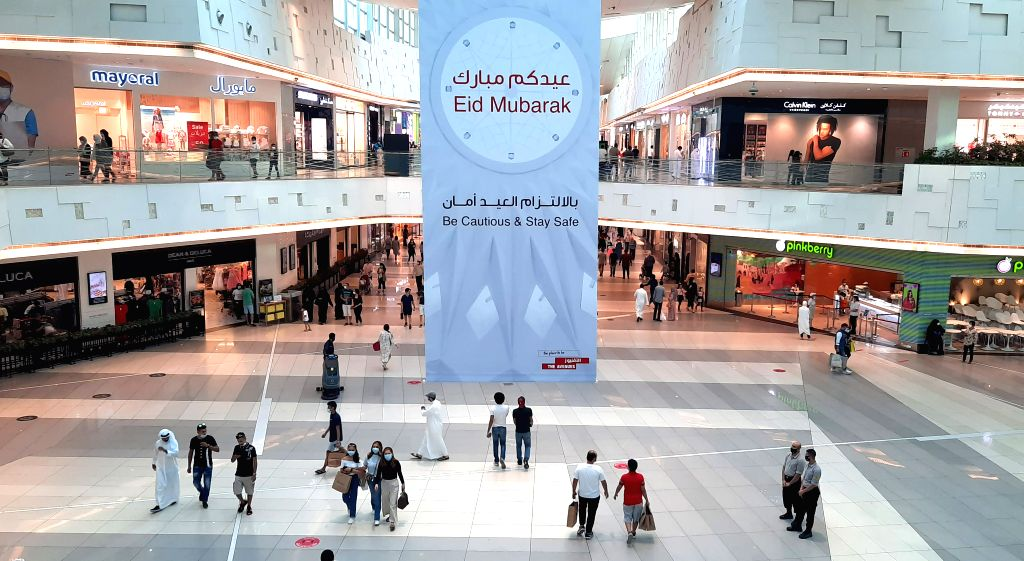 People are seen at a shopping mall during the first day of Eid al-Adha in Farwaniya Governorate, Kuwait, on July 31, 2020. As life is gradually returning to ...
