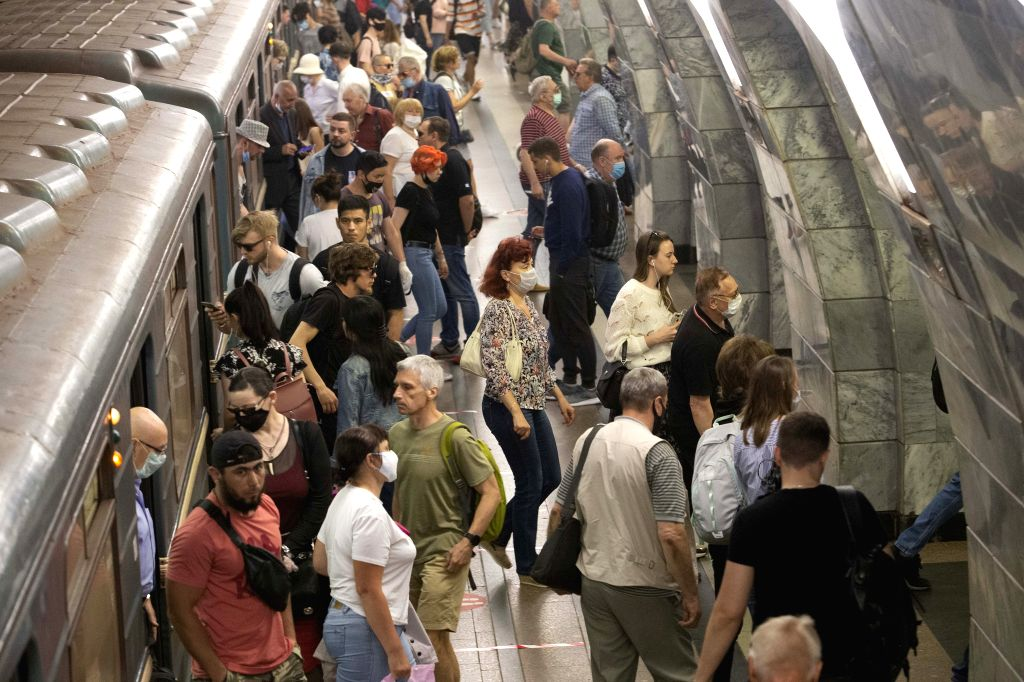 People are seen at a subway station in Moscow, Russia, on June 23, 2020. Russia recorded 7,425 COVID-19 cases in the past 24 hours, taking its total to 599,705, the ...