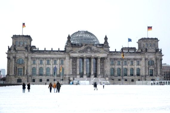 People are seen in front of the Bundestag building in Berlin, capital of Germany, Feb. 7, 2021.