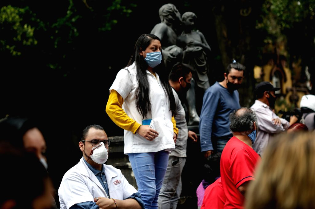 People are seen on a street after an earthquake in Mexico City, capital of Mexico, on June 23, 2020. An earthquake with a magnitude of 7.4 jolted 12 km SSW of ...