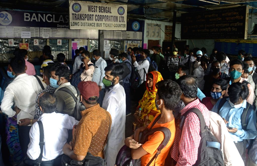 People are waiting to catch the bus at bus stand due to lockdown started from tomorrow in Kolkata  on Saturday, 15 May, 2021.