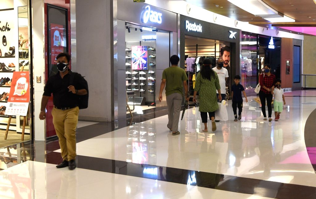 People arrive at a shopping mall following its reopening to the public today after the State Government announced relaxations on the ongoing lockdown during the coronavirus pandemic in ...