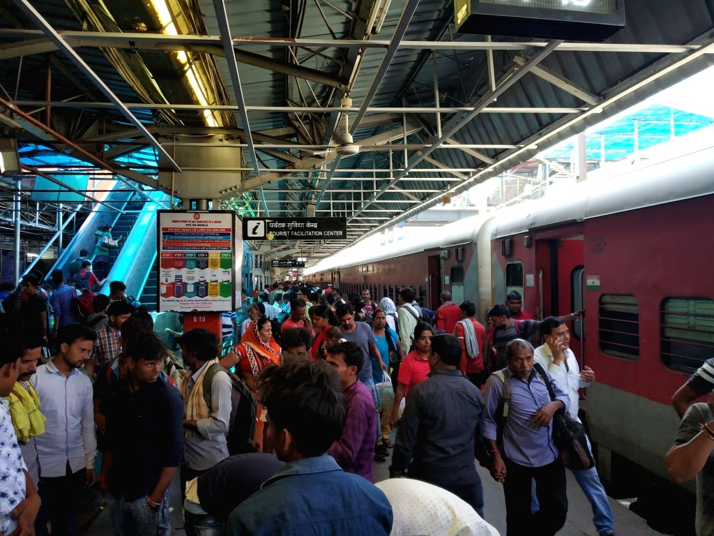 People arrive at New Delhi railway station on May 28, 2019. Due to unavailability of tickets in most fast and super fast trains during the summer holiday season, the Indian Railways is ...