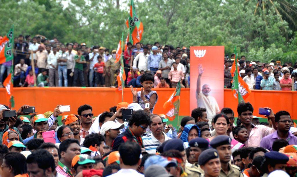 People arrive at Prime Minister Naredra Modi's rally in Balasore district of Odisha on June 2, 2016. - Naredra Modi