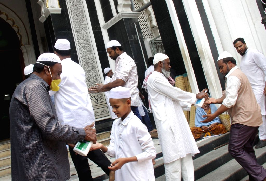 People arriving to offer Friday prayers being provided with hand sanitiser before entering the mosque amid COVID-19 (coronavirus) outbreak, in Bengaluru on March 20, 2020.