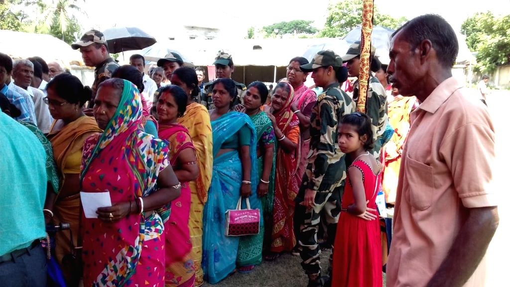 """People at a Mega Medical Health Camp organised by 27 Bn BSF on the occasion of """"Kargil Vijay Diwas"""" in Boltala, West Bengal on July 21, 2019."""