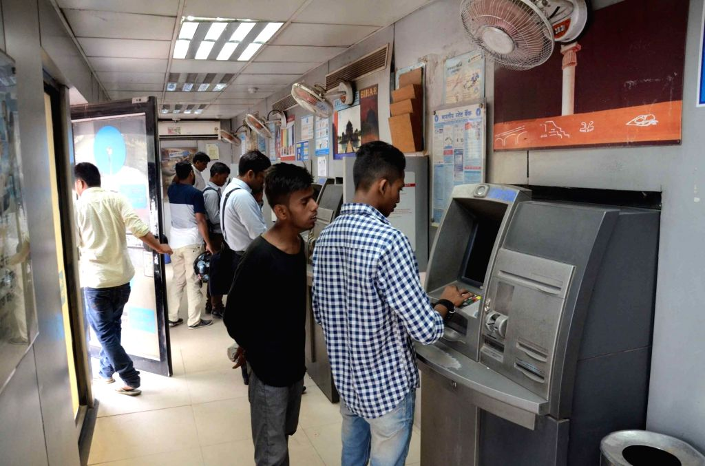People at a State Bank of India ATM during the nationwide bank strike spearheaded by the United Forum of Bank Unions (UFBU), an umbrella body of nine unions; in Patna on May 31, 2018. The ...