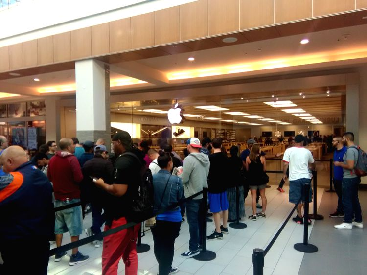 People at Apple Store in Roosevelt Field, Garden City in Long Island, New York, to buy stunning iPhone 7 and water-resistant Apple Watch Series 2.