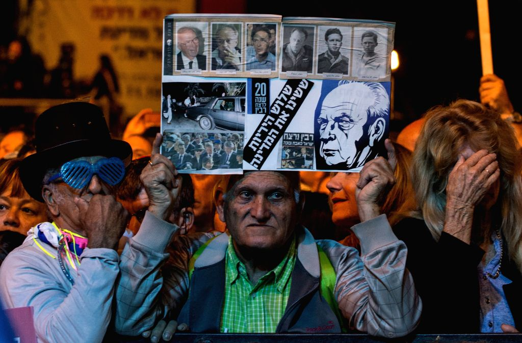 People attend a rally at the Tel Aviv square marking the anniversary of Rabin's assassination, Oct. 31, 2015. About 100,000 Israelis gathered to commemorate the ... - Yitzhak Rabin