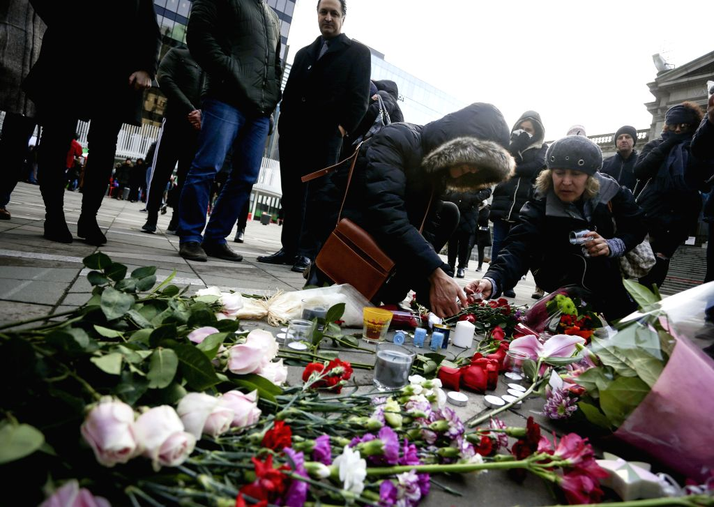 People attend a vigil outside Vancouver Art Gallery for victims of the Ukrainian passenger plane crash in Vancouver, Canada, Jan. 11, 2020. Iran admitted its ...