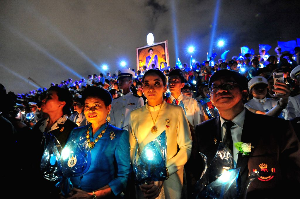 People attend an event celebrating Queen Sirikit's 83rd birthday at the Sanam Luang square in Bangkok, Thailand, on Aug. 12, 2015. Thailand on Wednesday observed ...