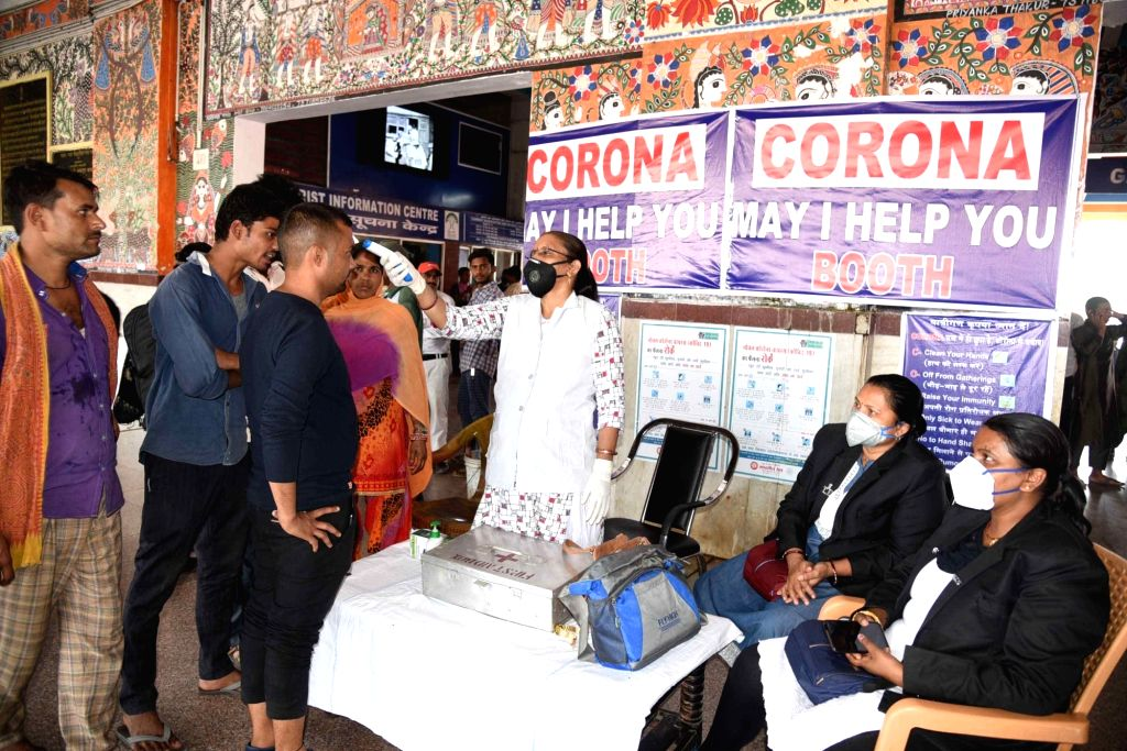People being screened for COVID-19 amid coronavirus pandemic at a 'corona may I help you' booth, in Patna on March 20, 2020.