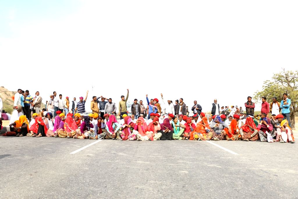 People belonging to Gujjar community stage a demonstration on National Highway (NH) 58 to demand five per cent reservation in jobs and educational institutions, in Ajmer, Rajasthan on Feb 10, ...