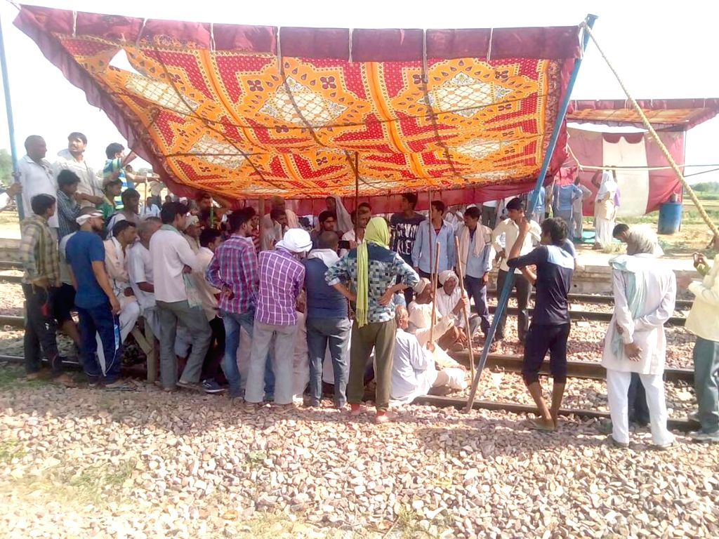 People belonging to Jat community stage a demonstration to press for reservation in jobs on Mathura-Alwar railway tracks near Govardhan on Uttar Pradesh-Rajasthan border on June 23, 2017.