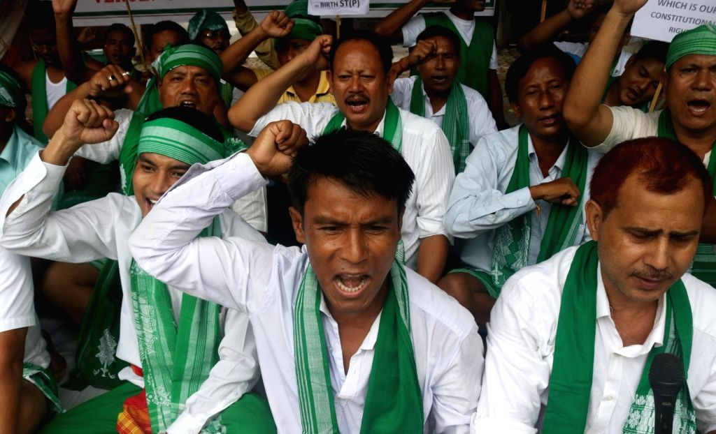 People belonging to Sarania Kachari community of Assam stage a demonstration to press for scheduled tribe status in New Delhi, on July 29, 2016.