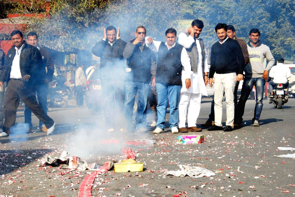 People belonging to the Jat community celebrate as the community was included in Central list of OBCs in Dehradun on Dec.20, 2013.