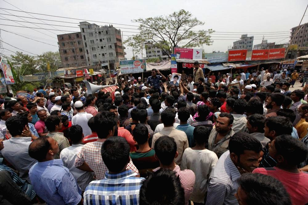 People block Dhaka-Chittagong highway at Siddhirganj to demand the release of Narayanganj City Corporation (NCC) panel mayor Nazrul Islam and his four associates in Dhaka on April 28, 2014.