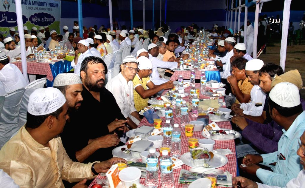 People break their fast during Iftaar after day-long fasting during the holy month of Ramadan, in Kolkata on May 20, 2018.