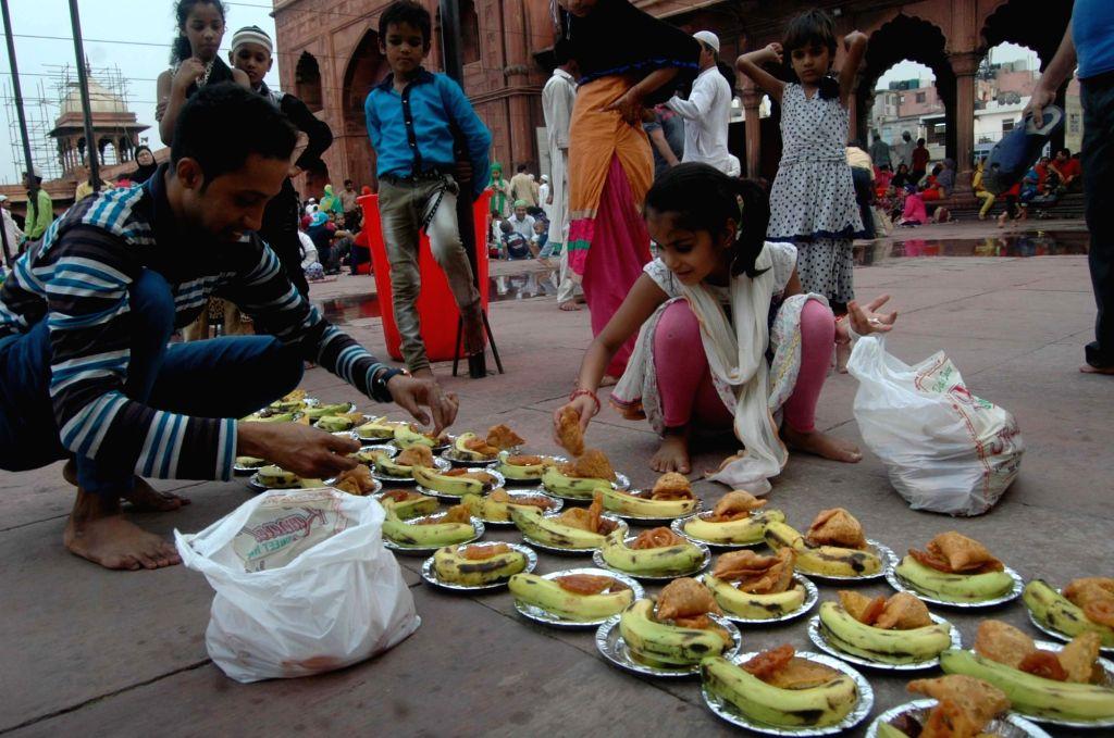 People break their fast during Ramadan at Jama Masjid in New Delhi, on June 13, 2017.