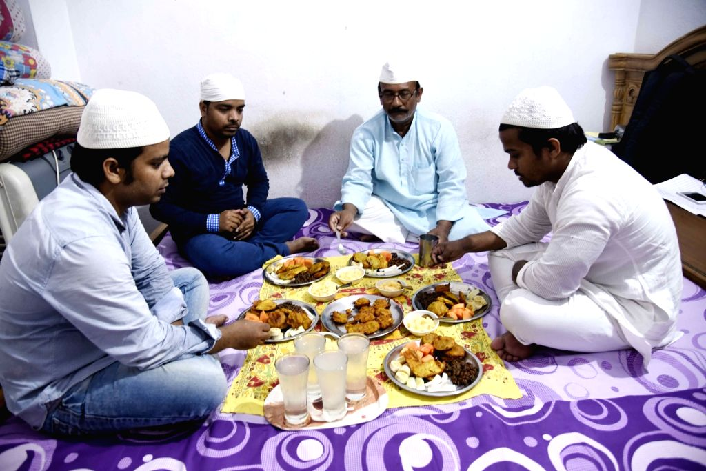 People break their fast during Ramadan in Patna on April 25, 2020.