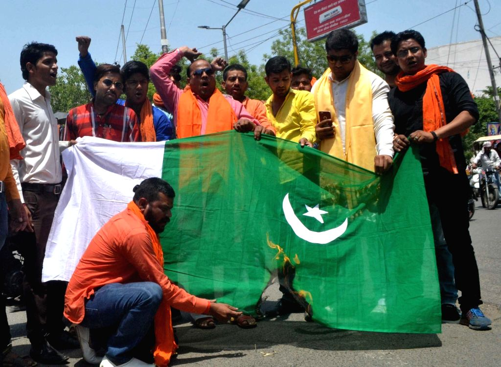 """People burn a Pakistani flag during a demonstration after an Army soldier and a BSF trooper were killed and """"mutilated"""" on the LoC in Jammu and Kashmir by Pakistani forces; in Agra on ..."""