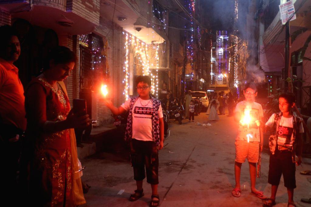 People burn crackers to celebrate Diwali in Delhi on oct. 27, 2019.