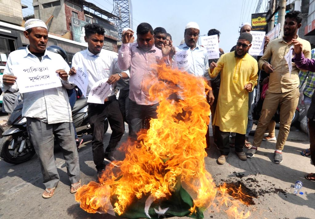 People burn Pakistan flag during a protest against suicide attack on a CRPF bus in Jammu and Kashmir's Pulwama district in which atleast 45 soldiers lost their lives; in Guwahati on Feb 15, ...