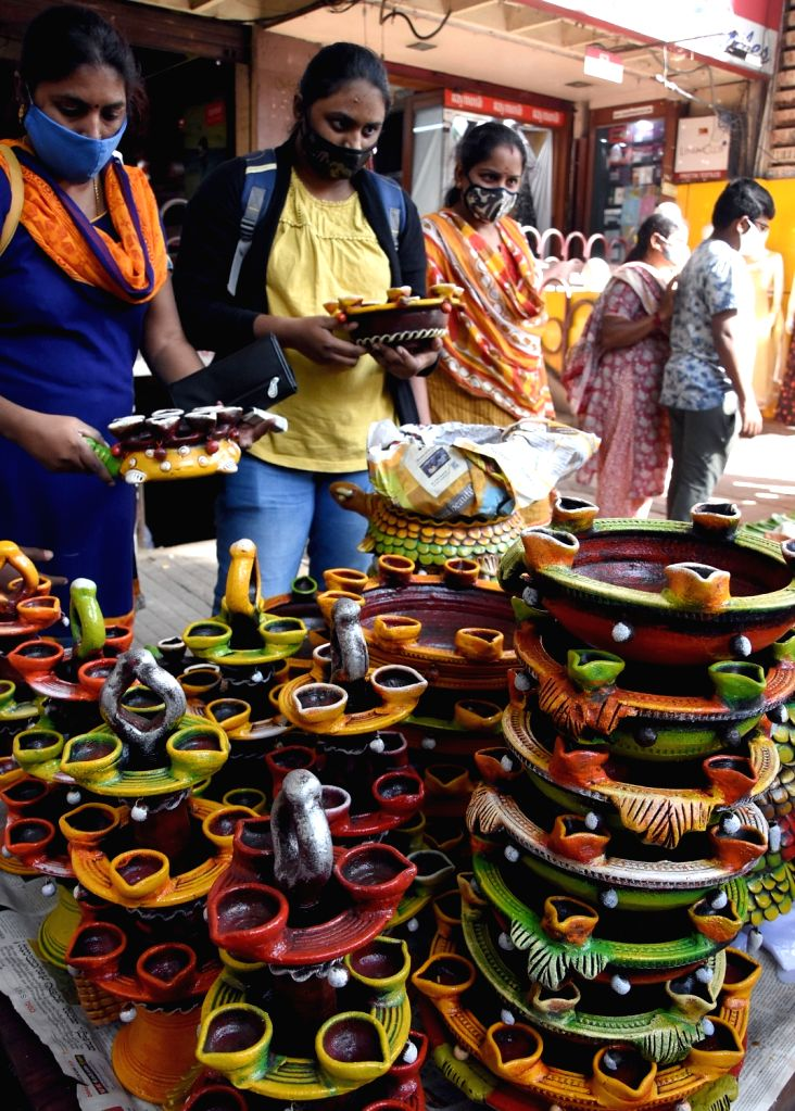 People busy buying colorful lanterns and earthen lamps, in Bengaluru on Nov 13, 2020.