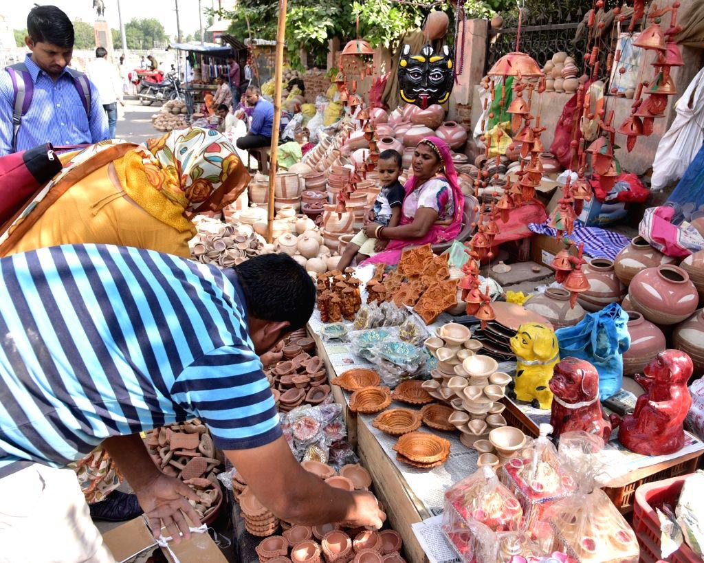 People busy buying earthen lamps ahead of Diwali - festival of lights in Bikaner on Nov. 1, 2018.