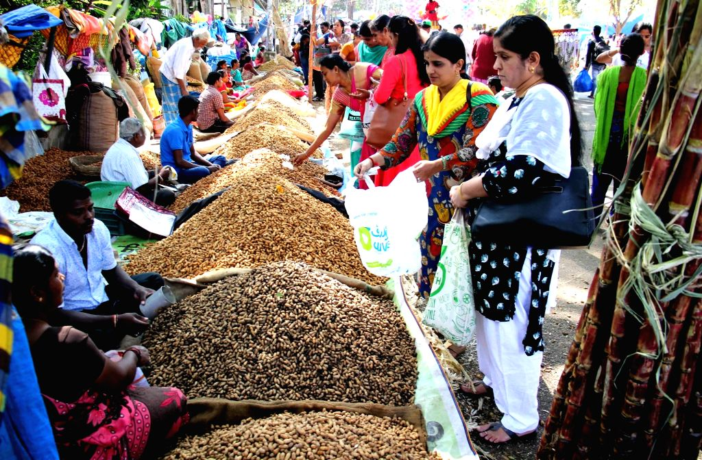People busy buying groundnuts during Kadalekai Parishe - annual groundnut fair at Bull Temple in Bengaluru's Basavanagudi on Dec 3, 2018.
