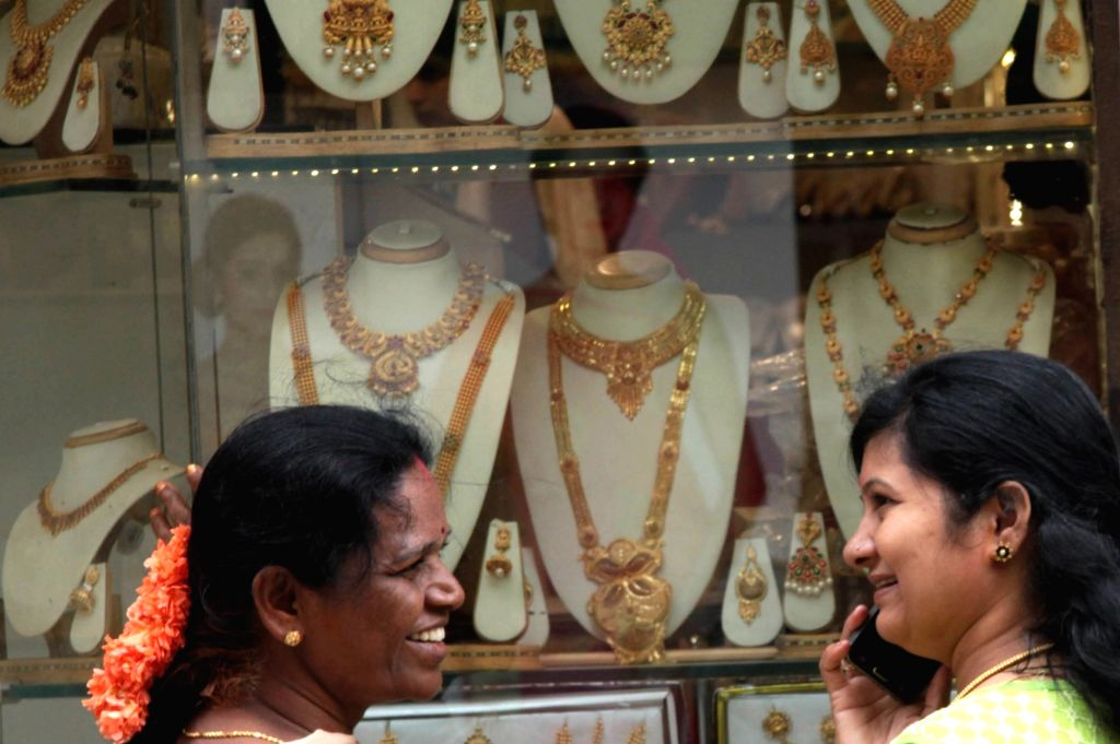 People busy buying jewellery at a showroom ahead of roll out of GST in Bengaluru on June 30, 2017.