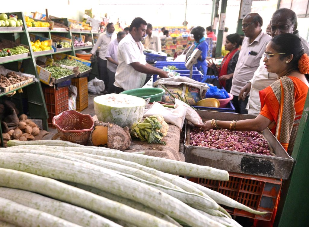People busy buying vegetables ahead of Sunday's 'Janata Curfew' announced by Prime Minister Narendra Modi where people have been urged to stay indoors and take precautions to contain the ... - Narendra Modi