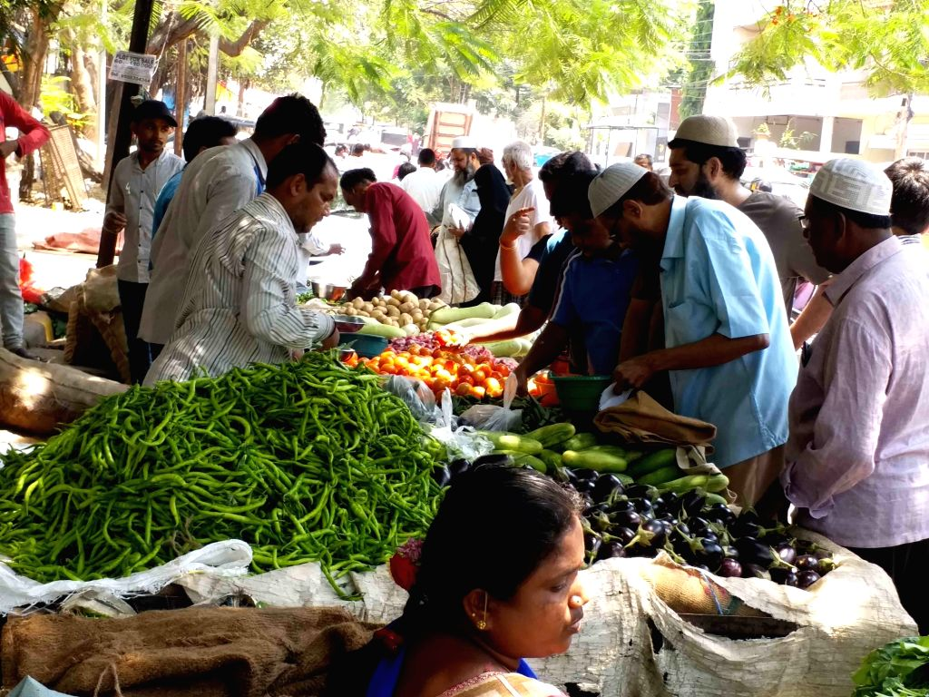 People busy buying vegetables at a street-side green grocery store on the eve of 'Janata Curfew' in Hyderabad on March 21, 2020.