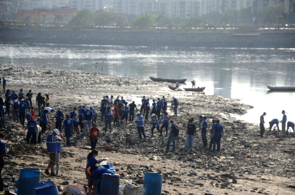 People busy cleaning sea beach in Mumbai on June 1, 2019.