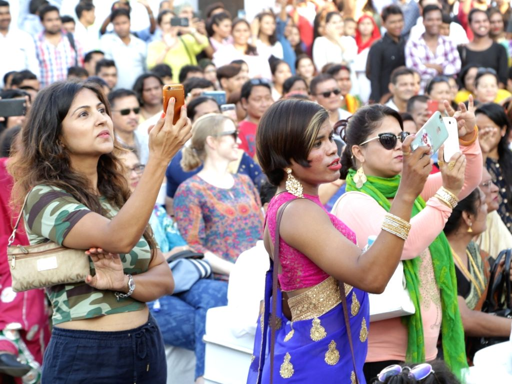 """People busy clicking photos of transgender artistes performing during the """"7th Hijra Habba"""" programme, in New Delhi on Sept 11, 2018."""