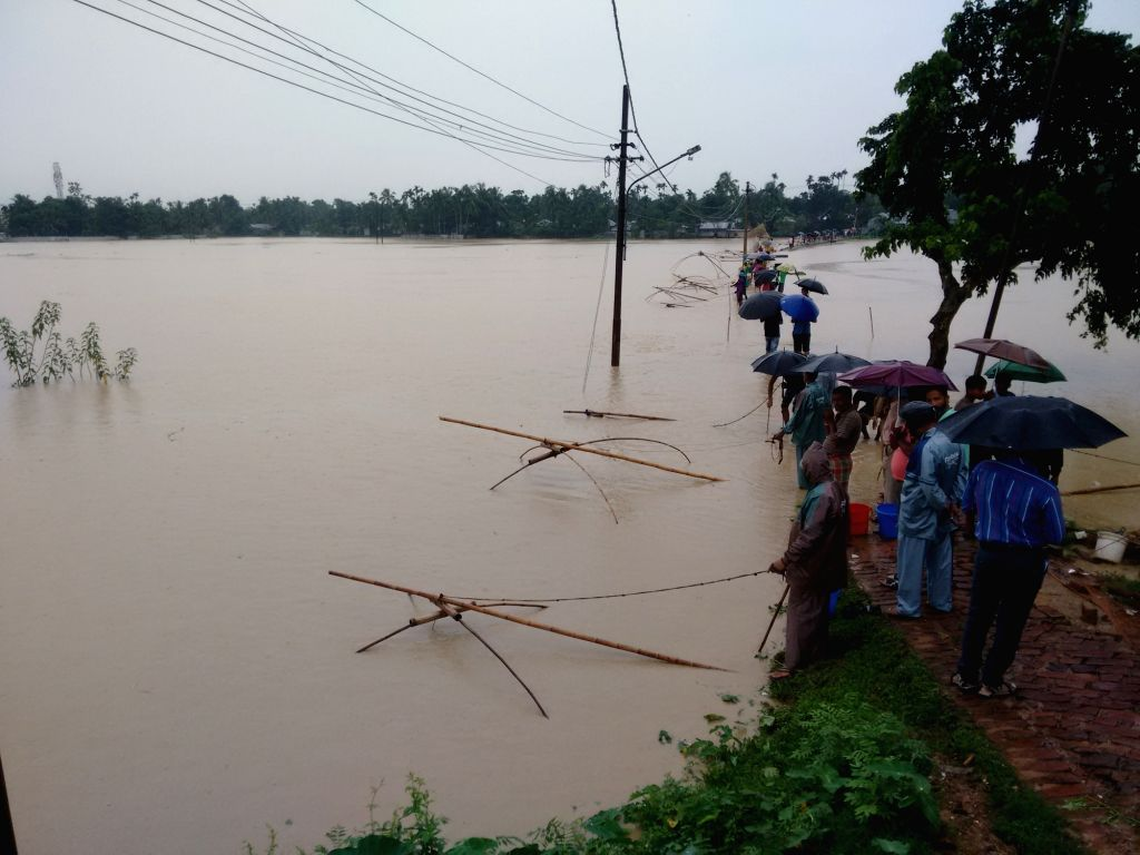 People busy fishing in flood waters on the outskirts of Agartala.