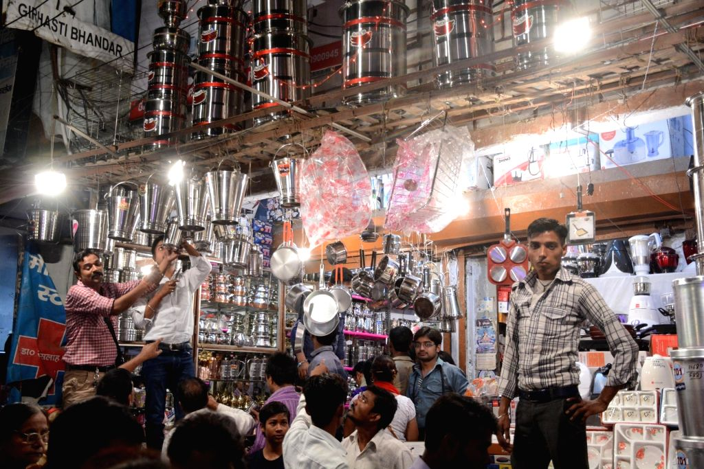"""People busy purchasing utensils on """"Dhanteras"""" in Lucknow on Oct 28, 2016."""