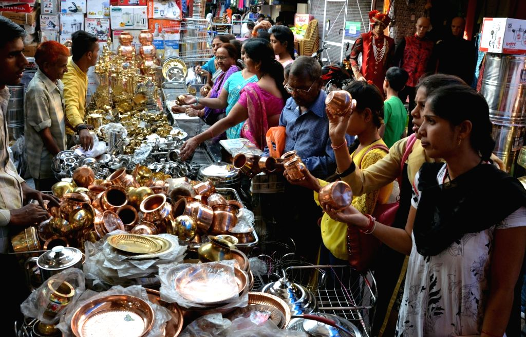 """People busy purchasing utensils on """"Dhanteras"""" in Bhopal on Oct 28, 2016."""