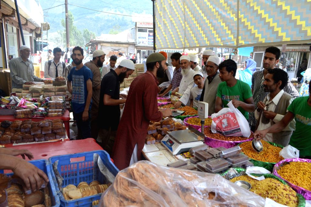 People busy shopping ahead of Eid ul-Fitr in Baramulla of Jammu and Kashmir, on July 16, 2015.