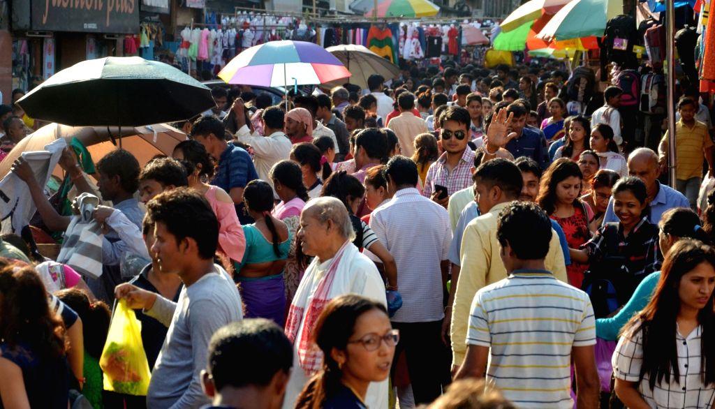 People busy shopping ahead of Rongali Bihu in Guwahati, on April 13, 2018.