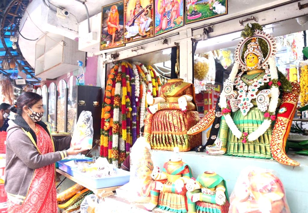 People busy shopping ahead of Varamahalakshmi celebrations, at Gandhi Bazaar in Bengaluru on July 30, 2020.