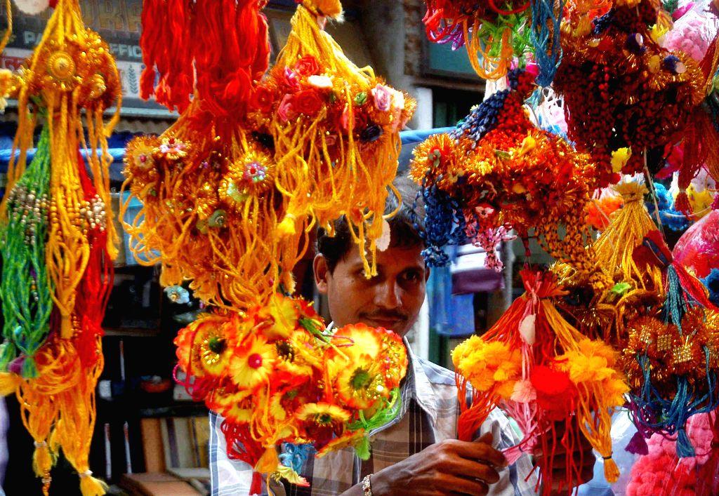 People busy shopping for Rakhi on the eve of Raksha Bandhan in Kolkata, Aug 9, 2014.