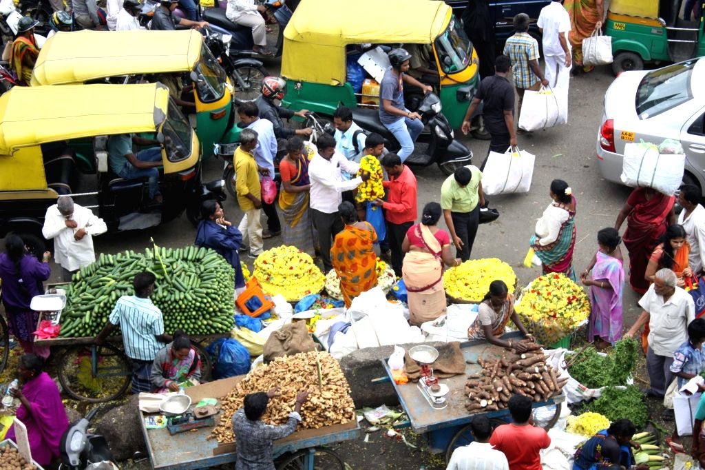 People busy shopping on the eve of Ayudha Puja at a market in Bengaluru on Sept 28, 2017.