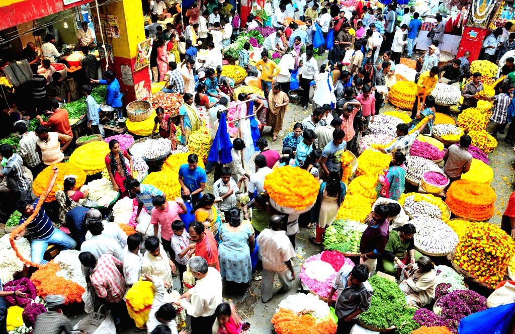 People busy shopping on the eve of Ganesh Chaturthi at K R Market of Bangalore on Aug 28, 2014.