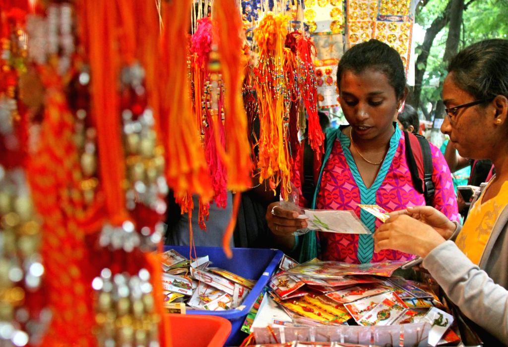 People busy shopping on the eve of Raksha Bandhan in Bengaluru, on Aug 17, 2016.