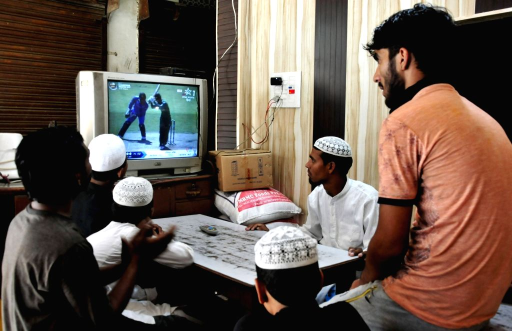 People busy watching ICC Champions Trophy Final match between India and Pakistan that is being played in London's Kennington Oval; in Amritsar on June 18, 2017.