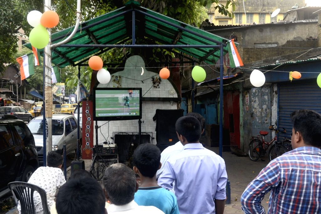 People busy watching ICC Champions Trophy Final match between India and Pakistan that is being played in London's Kennington Oval; in Kolkata on June 18, 2017.