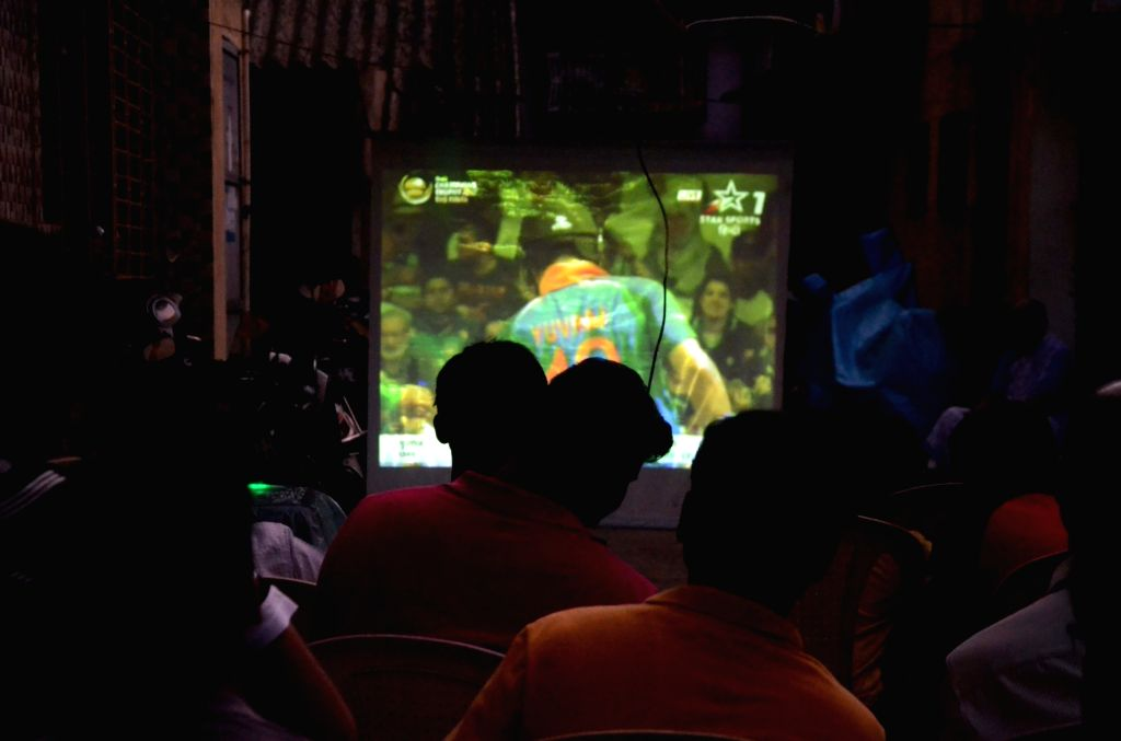 People busy watching ICC Champions Trophy Final match between India and Pakistan that is being played in London's Kennington Oval; in Mumbai on June 18, 2017.
