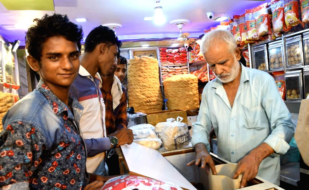 People busy with Eid shopping in Patna, on June 23, 2017.