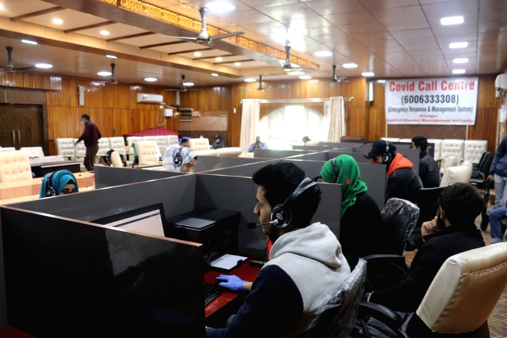 People busy working at the first Covid-19 response call centre developed and launched by the Jammu and Kashmir administration in Srinagar, during the extended nationwide lockdown imposed to ...